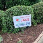 Georgia school graduation yard sign in front yard