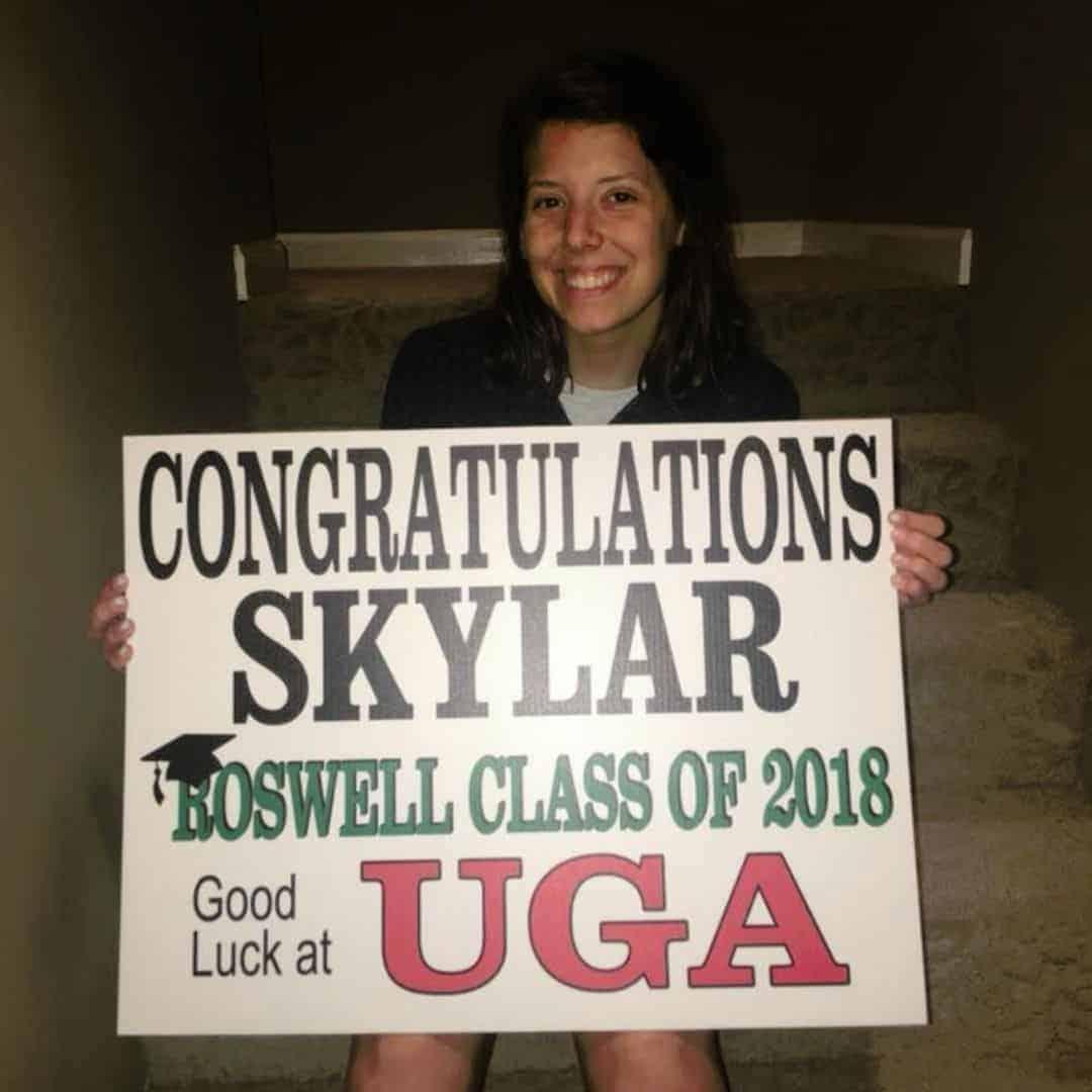 high school senior Skylar with graduation sign